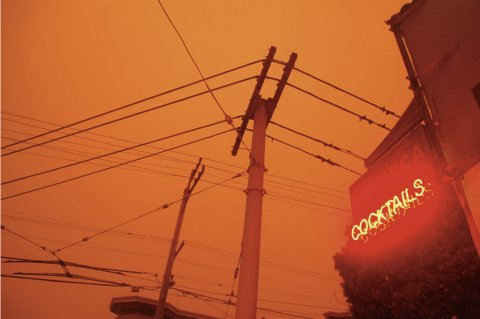 A blanket of wildfire smoke darkened skies, as seen at the corner of 18th and Connecticut streets. September 9, 2020, 9 a.m. Photo: Carmen Herraiz